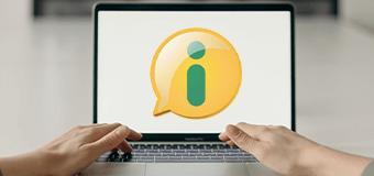 Tela de notebook com logotipo do SIC (balão amarelo com letra i em verde)